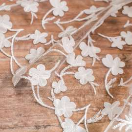 LASER CUT SATIN EMBROIDERY ON TULLE. DOUBLE BORDER. LIGHT IVORY